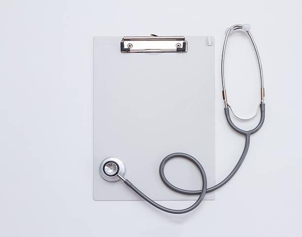 Medical stethoscope on white background. stock photo