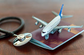 istock Medical Stethoscope , passport and an airplane. Global Healthcare and travel insurance concept 1136682928
