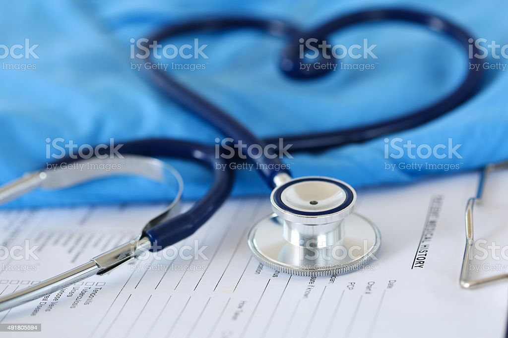 Medical stethoscope twisted in heart shape stock photo