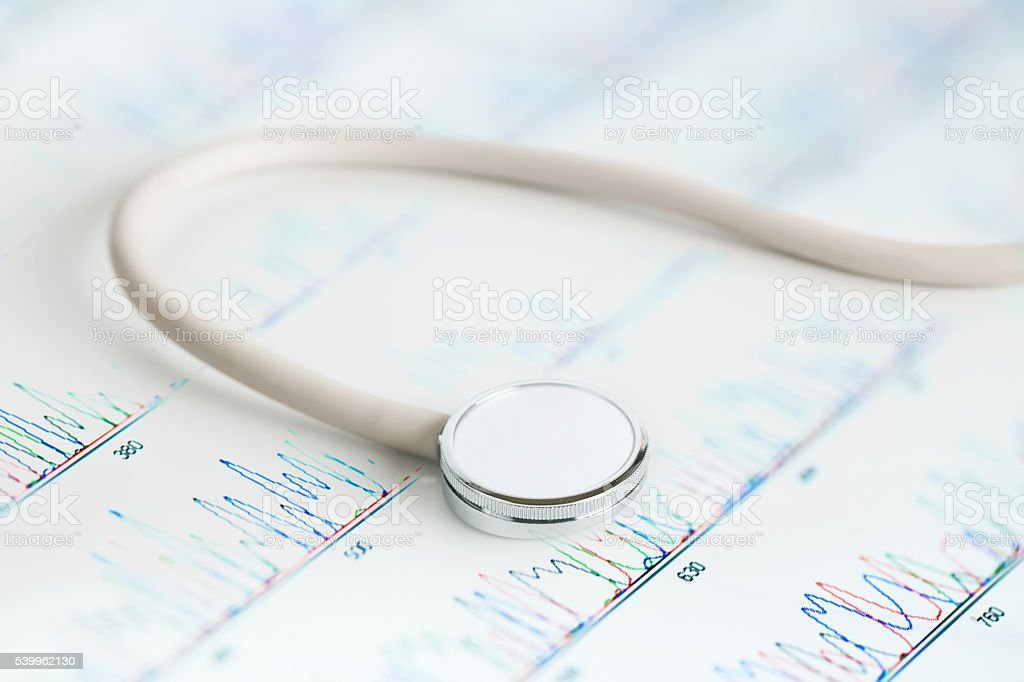 Medical stethoscope with DNA sequence peaks stock photo