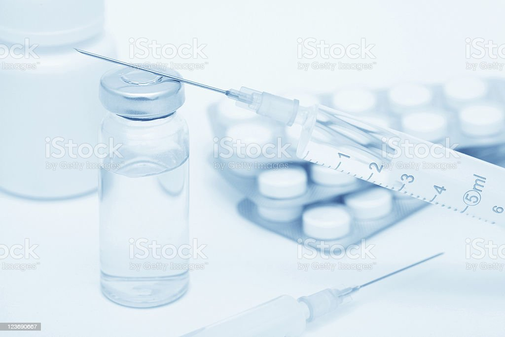 Medical still-life with syringes and tablets (blue toed) royalty-free stock photo