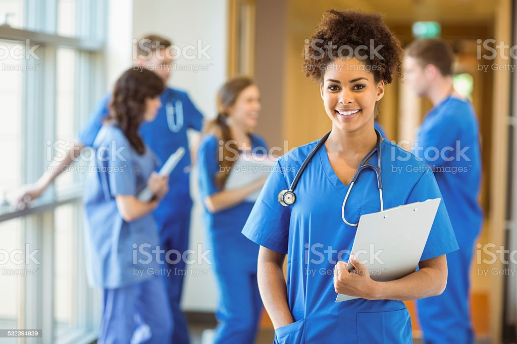 Medical student smiling at the camera stock photo