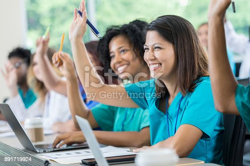 istock Medical students raise hands during class 891719924