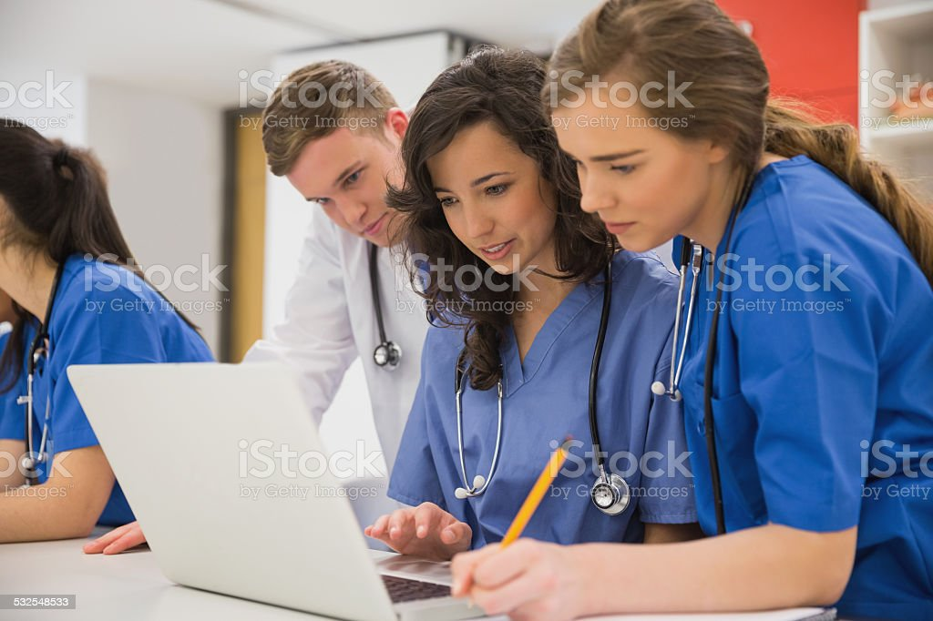 Medical students sitting and talking stock photo