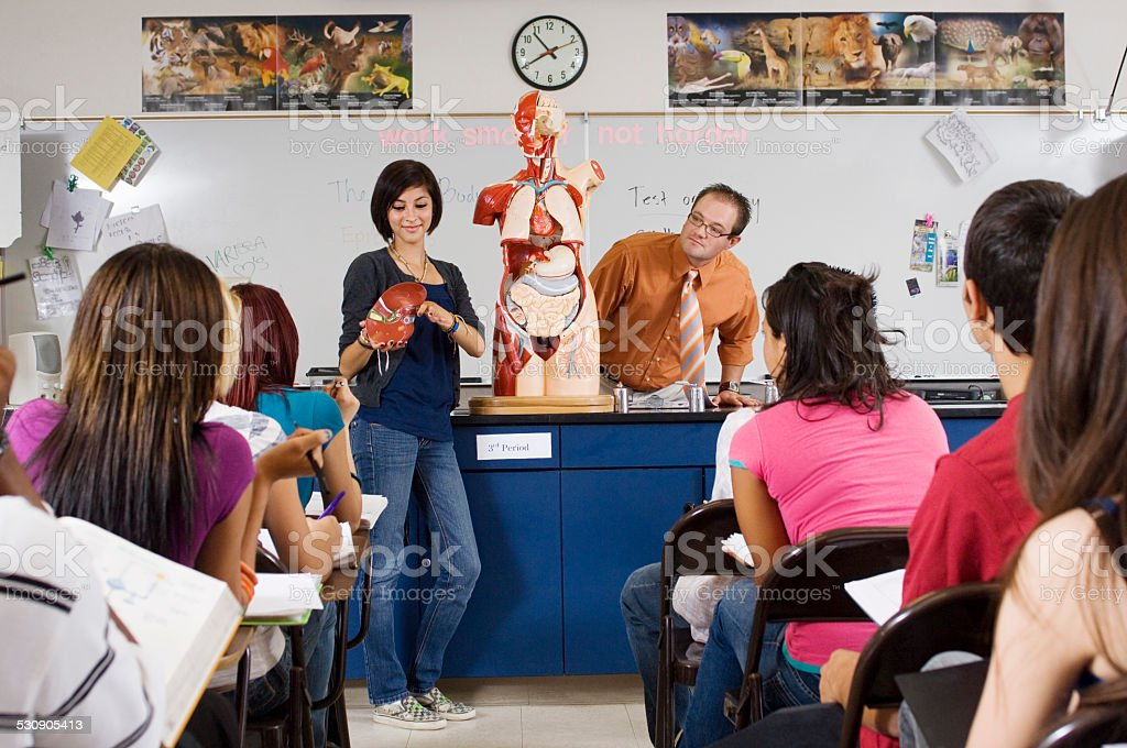 Medical Students With Professors In Classroom stock photo
