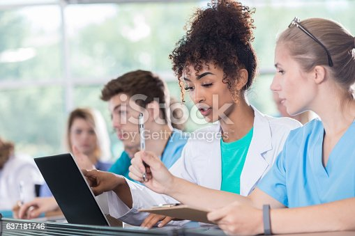 istock Medical students work on project together in class 637181746