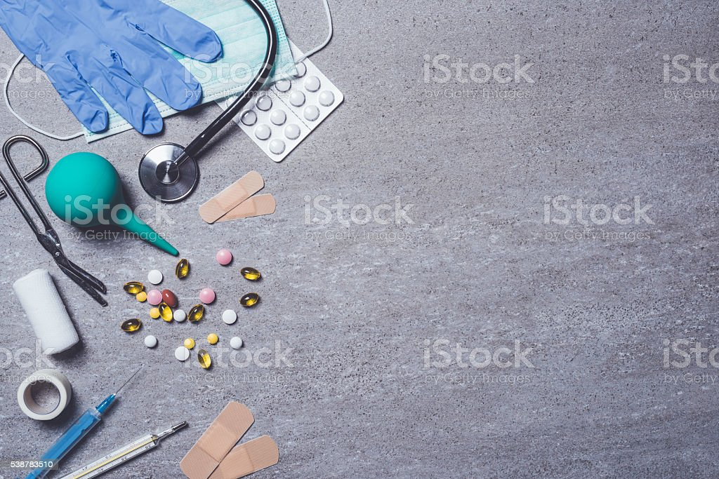 Medical supplies on stone background stock photo