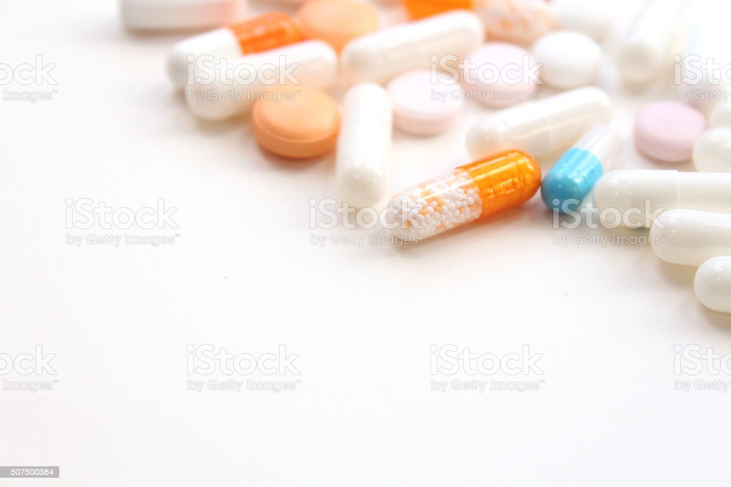 Medical supplies, pills and capsules stock photo