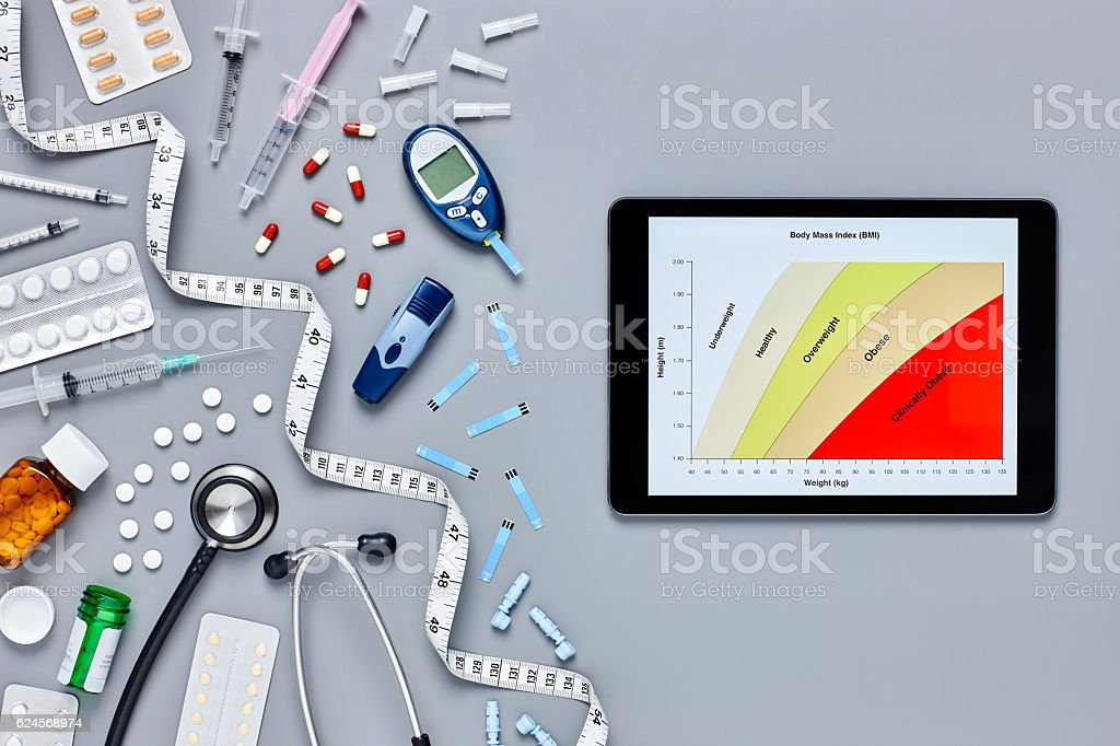 Medical supplies with computer displaying body mass index stock photo