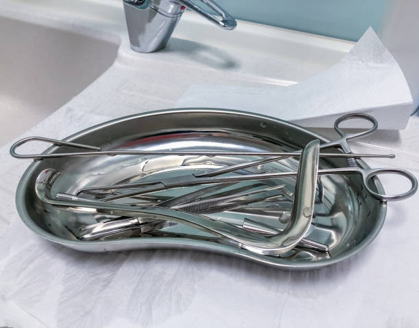 medical surgical instruments, scissors for surgery on a tray - medical technology стоковые фото и изображения