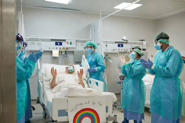Medical Team and Patient Expressing Support and Gratitude stock photo