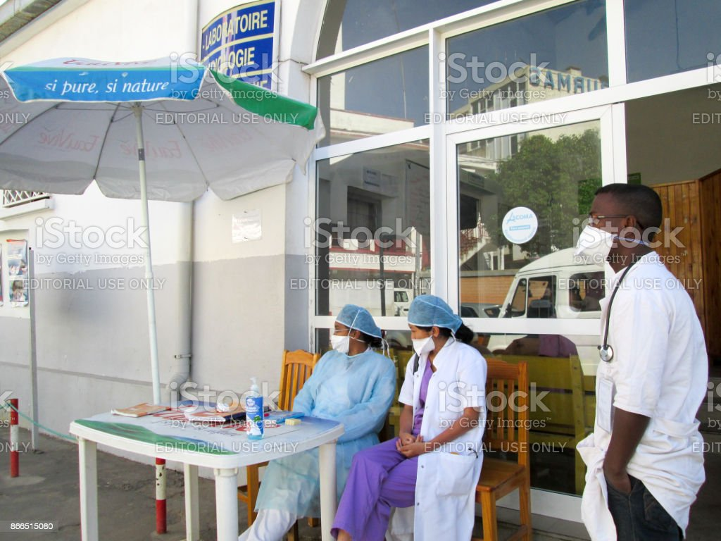 Medical team consisting of doctors, nurses and interns waiting to carry out a rapid diagnostic test (RDT) to patients suffering from pneumonic plague at the children's hospital of Antananarivo during the plague period in Madagascar stock photo