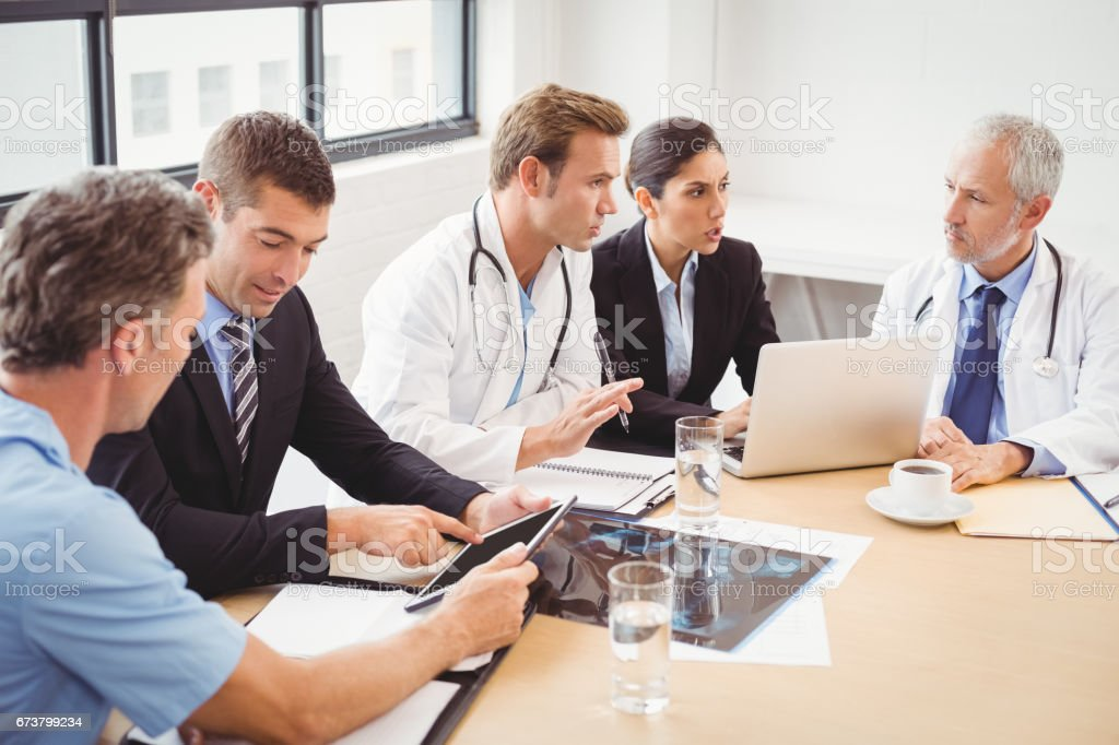 Medical team having a meeting in conference room stock photo
