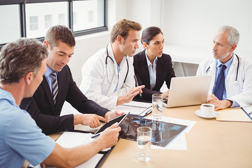 Medical Team Having A Meeting In Conference Room Stock Photo - Download Image Now
