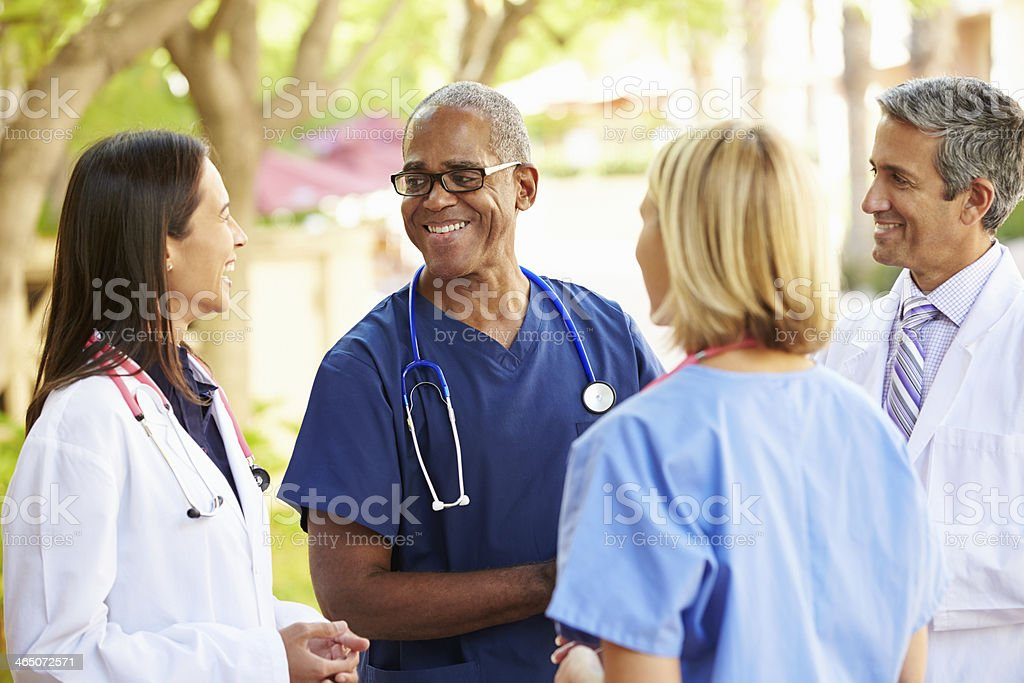 Medical team having a talk outdoors stock photo