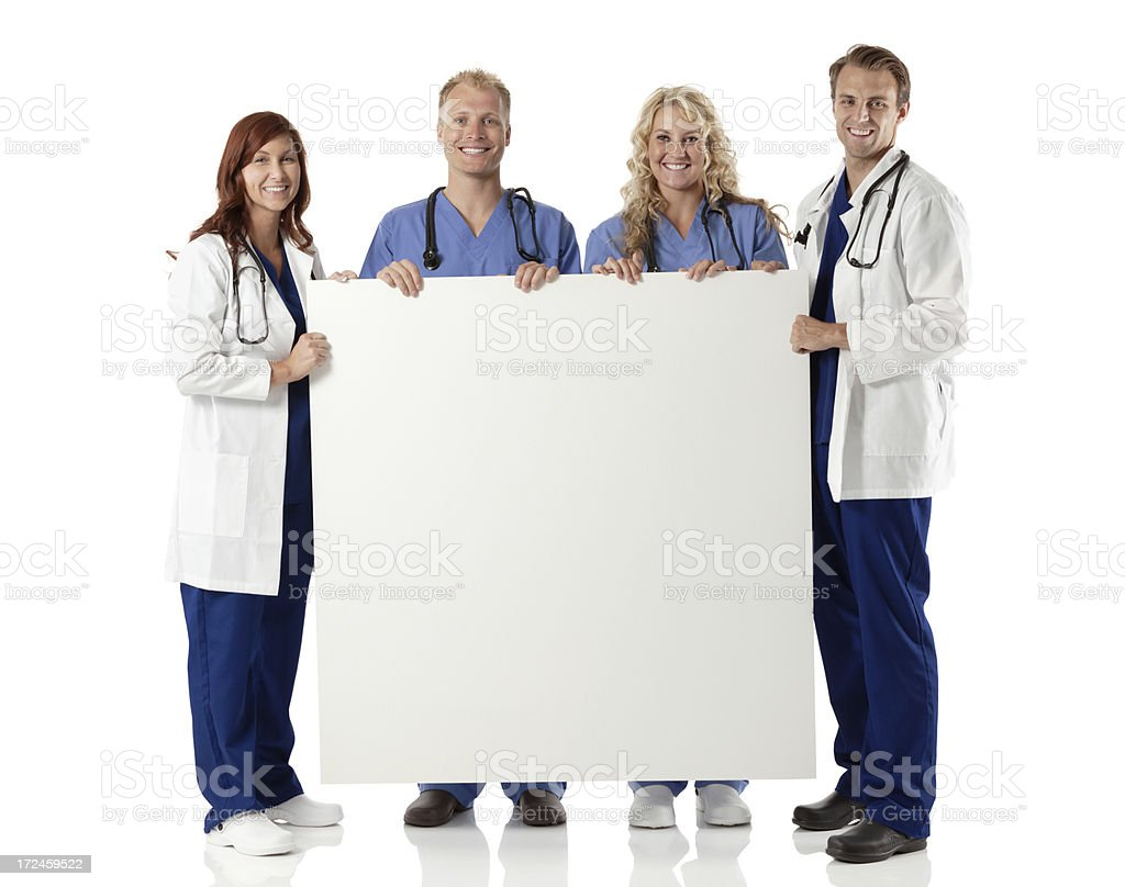 Medical team holding a placard royalty-free stock photo