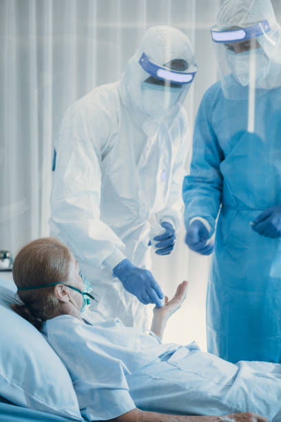 Medical Team invesigate patient history after old woman has been infected on coronavirus stock photo