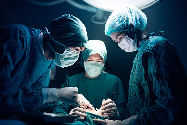Medical team performing surgery stock photo