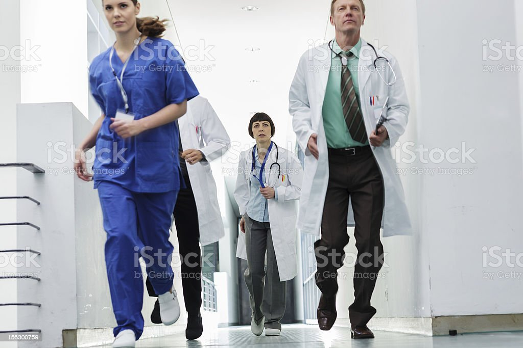 Medical team rushing to emergency royalty-free stock photo
