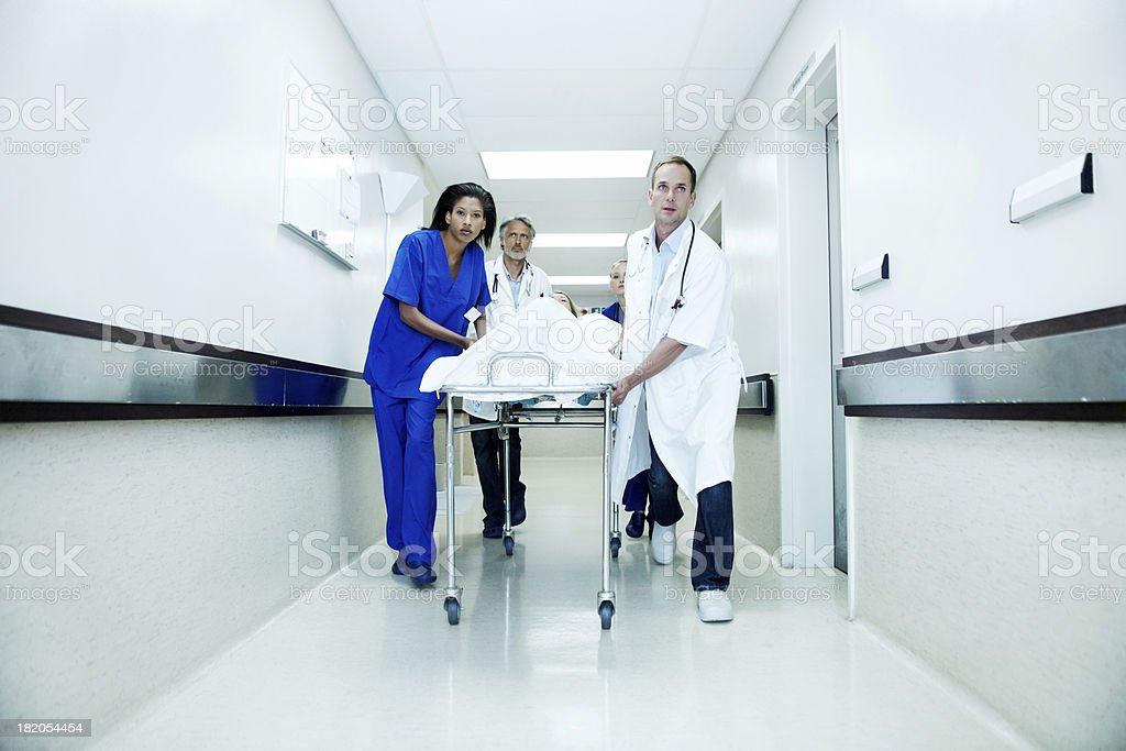 Medical team rushing to save a life stock photo