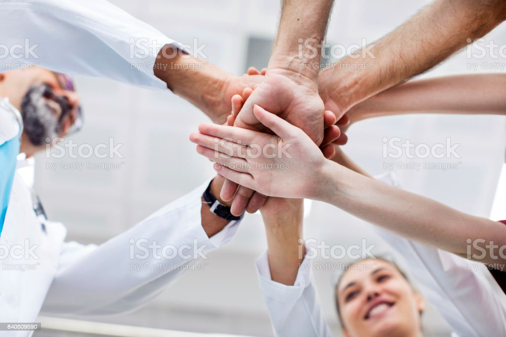 Medical team stacking hands stock photo