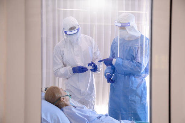 Medical teamwork helping to find vaccine and solution concept on Coronavirus. stock photo