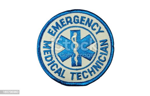 Isolated on white with clipping path.Generic emergency medical technician patch with star of life symbol.
