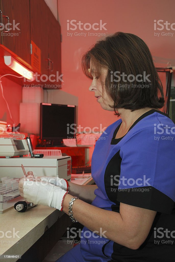 Medical technlogist performing lab test royalty-free stock photo
