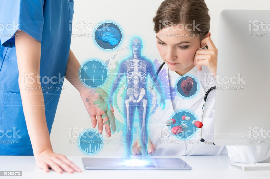 Medical technology concept. Doctor and nurse watching electronic medical record. stock photo