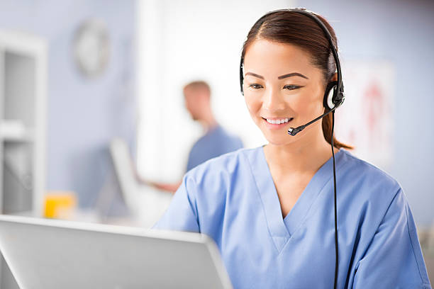 medical telephone assistance - nurse on phone stock photos and pictures