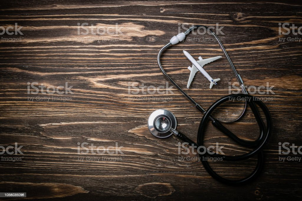 Medical tourism concept - stethoscope, airplane stock photo