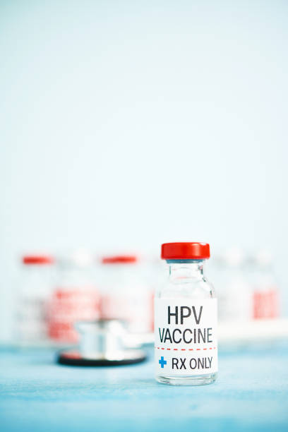 medical vial with hpv vaccine - hpv vaccine stock photos and pictures