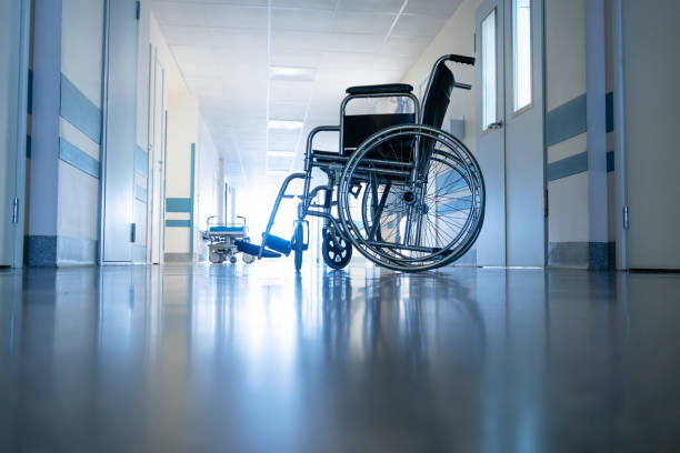 Medical wheelchair in the hospital corridor. stock photo