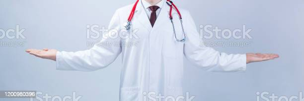 Medical wide background the doctor opened his hands in the side a or picture id1200980396?b=1&k=6&m=1200980396&s=612x612&h=lws1i22lmwfedr6o itfpty3xnum16n kz8stxh3fqq=