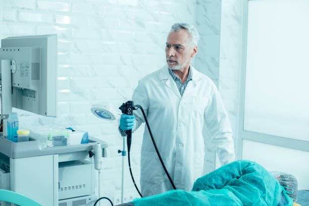 Medical worker and his patient before the endoscopy stock photo
