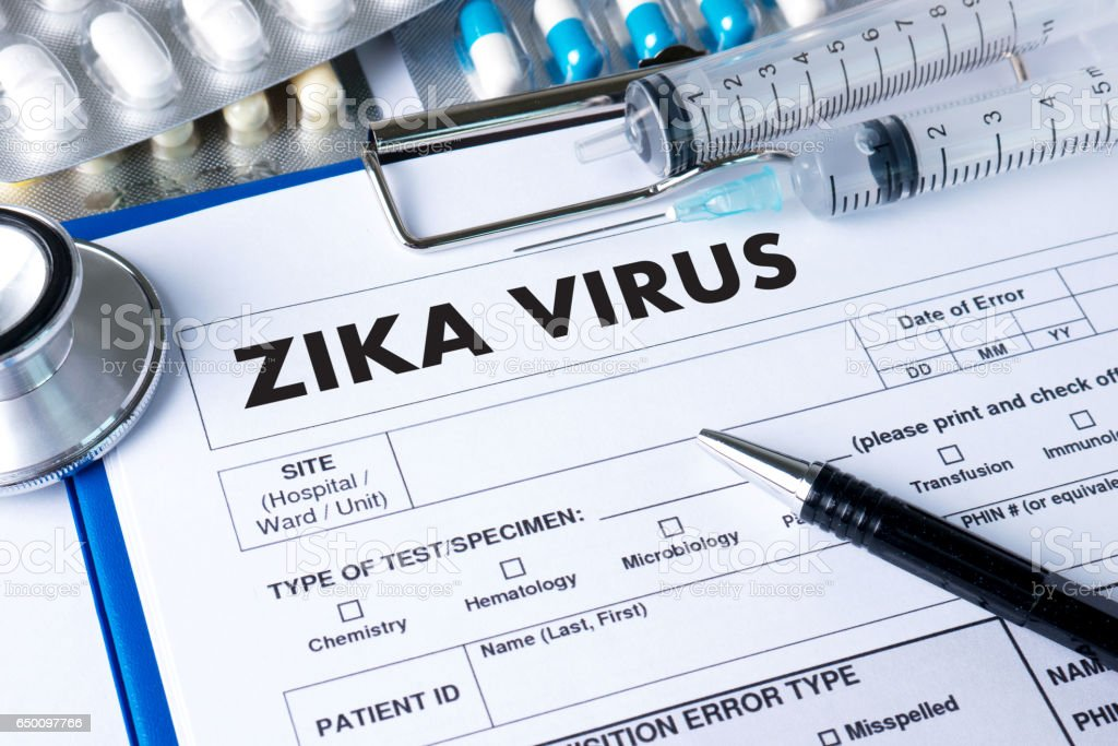 ZIKA VIRUS medical worker in protective clothes stock photo