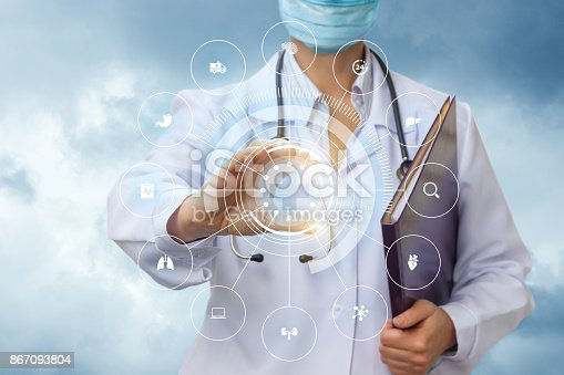 istock Medical worker shows the icons of the examination of the internal organs . 867093804