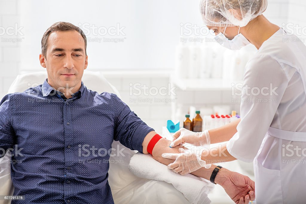 Medical worker undergoing collecting analysis stock photo