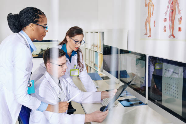 Medical workers discussing chest x-ray stock photo
