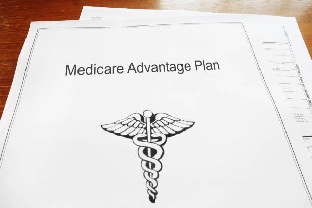 Medicare Advantage Healthcare document Medicare Advantage retirement healthcare document on a desk medicare stock pictures, royalty-free photos & images