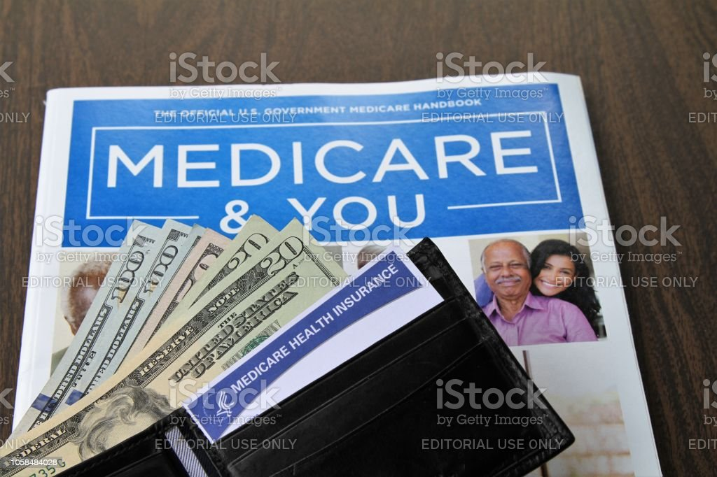 Medicare and Social Security cards with USA currency cash. Cards and...