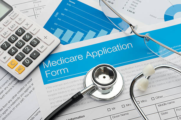 Medicare application form with stethoscope Medicare application form with stethoscope and paperwork medicare stock pictures, royalty-free photos & images