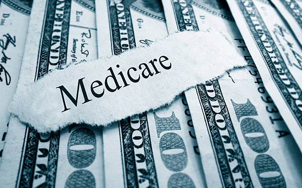 Medicare bills Medicare paper headline on hundred dollar bills medicare stock pictures, royalty-free photos & images