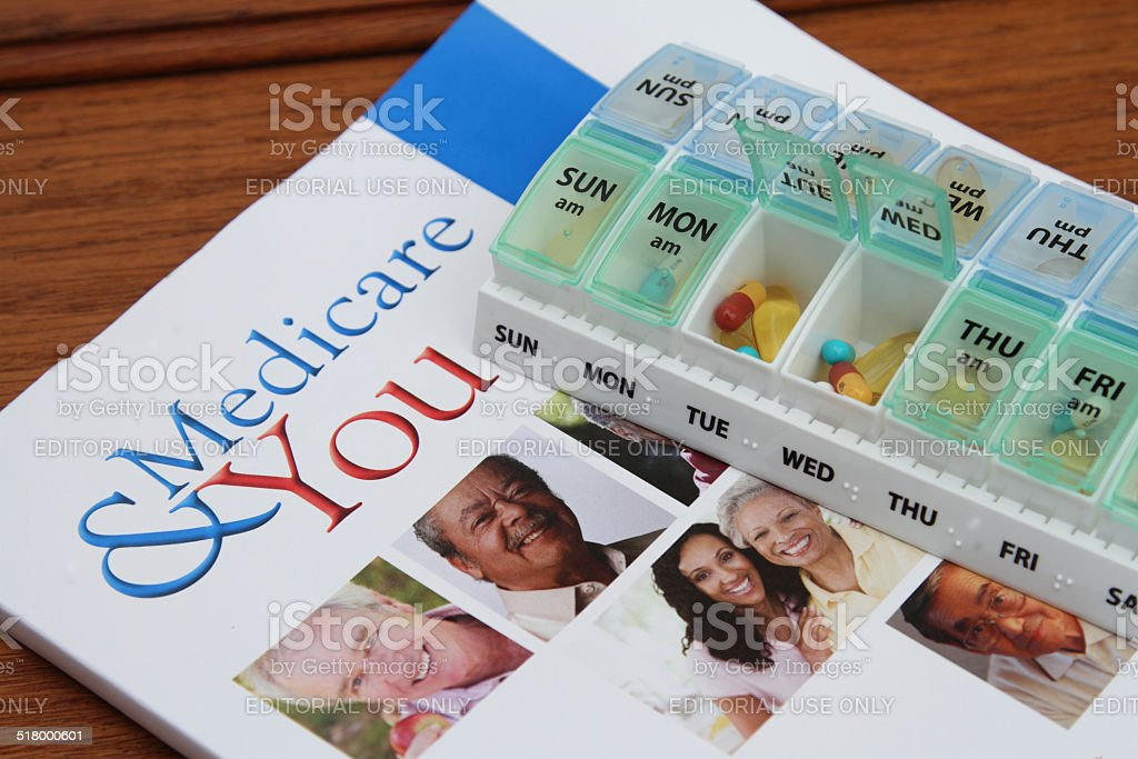 Medicare booklet and pills stock photo