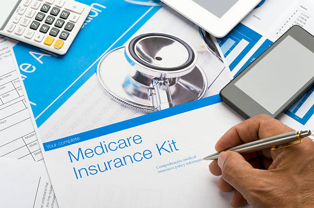 Medicare brochure Medicare brochure with paperwork. The included image can also be found in my portfolio. Image  #31376536 enrollment stock pictures, royalty-free photos & images