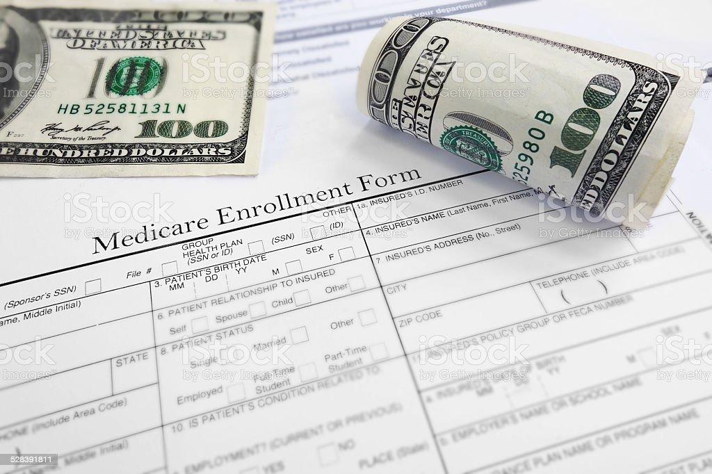 Medicare enrollment form and cash