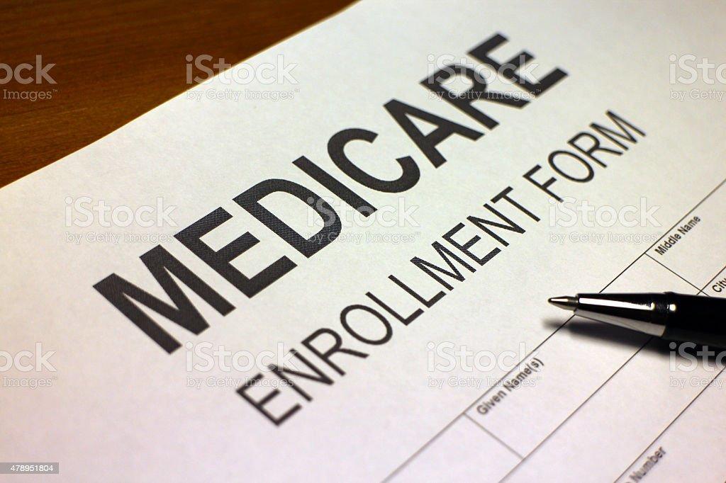 Someone filling out Medicare Enrollment Form.