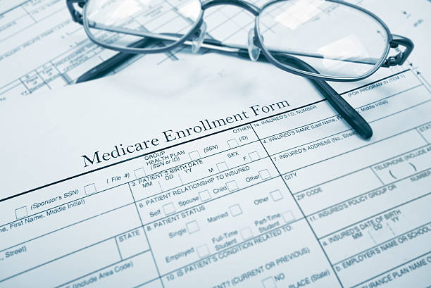 Medicare enrollment form Medicare enrollment form and glasses medicare stock pictures, royalty-free photos & images