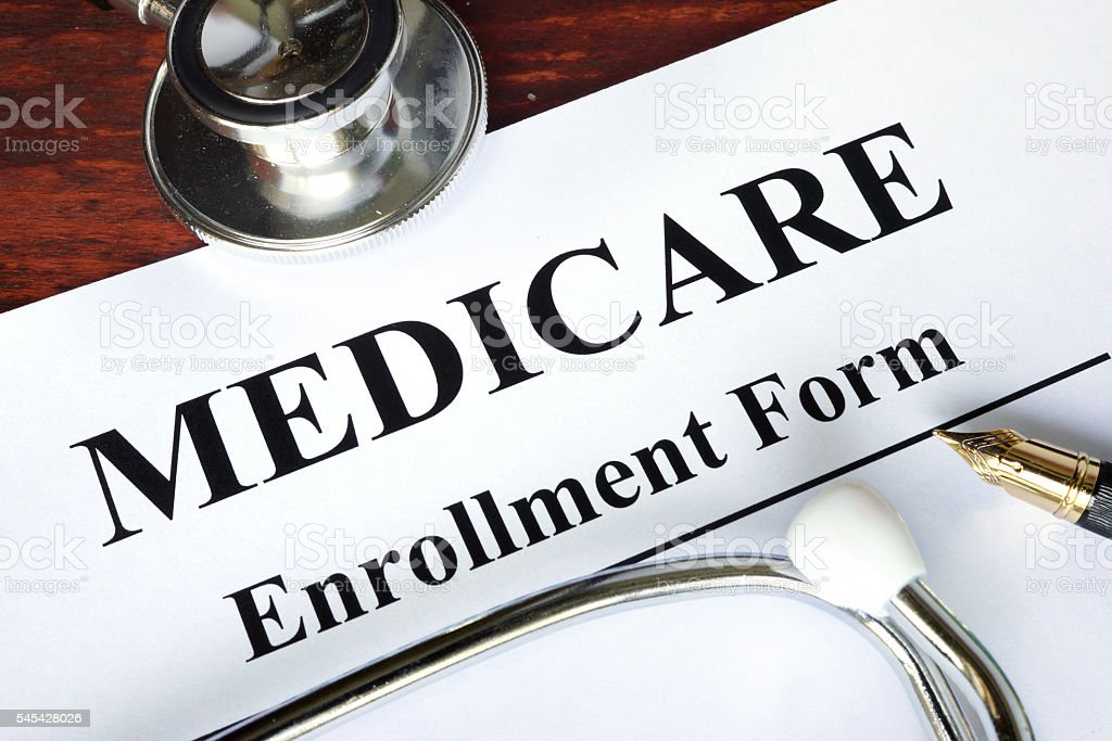 Medicare enrollment form written on a paper. stock photo