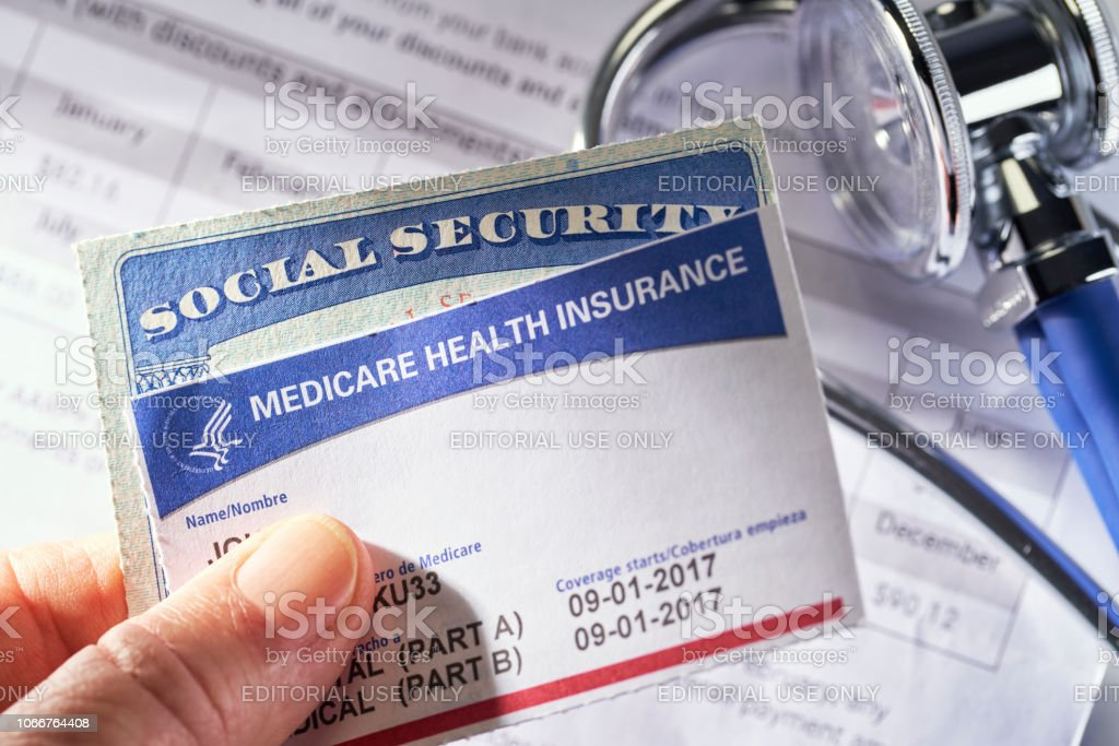 Medicare Health Insurance card on medical bill, calculator and...